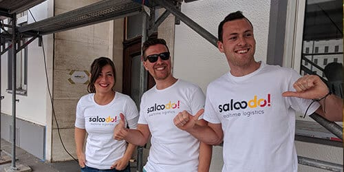 Three colleagues from Saloodo! in front of the company headquarters when it was under construction.