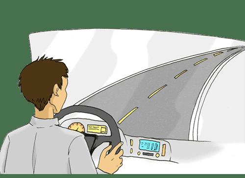Ein LKW-Fahrer blickt aus dem Cockpit auf die Straße.