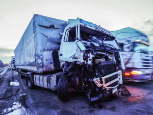 Truck with dented cab after rear-end collision