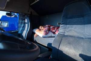 Truck driver sleeps in driver's cab