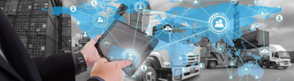 Supply chain manager using laptop to ulliustrate trends in supply chain