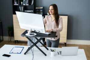 Woman standing at her desk working